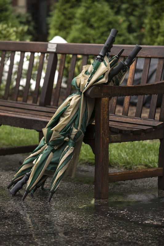 umbrellas for guests at stan hywet wedding ceremony