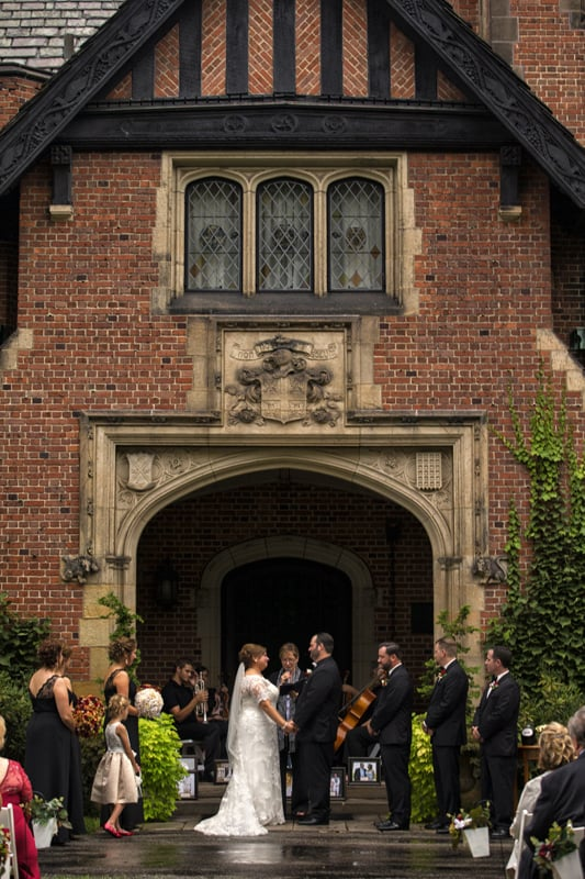 wedding ceremony in front entrance to stan hywet