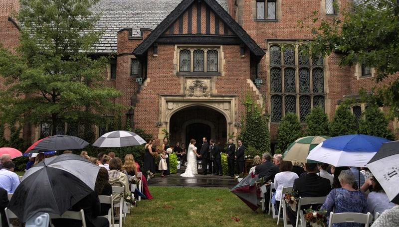 rainy wedding ceremony at stan hywet