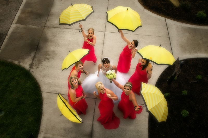bridesmaids outside firestone with umbrellas
