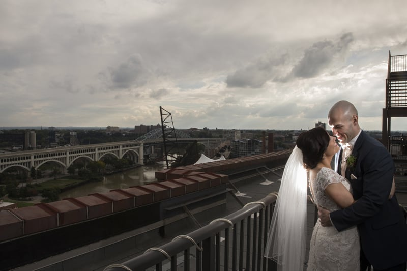 bride and groom overlooking cleveland