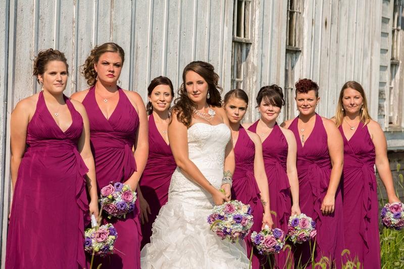 bridesmaids against barn