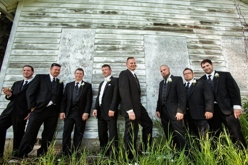 groomsmen against barn