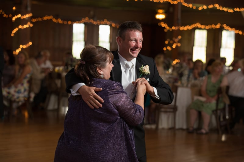 mom dancing with groom