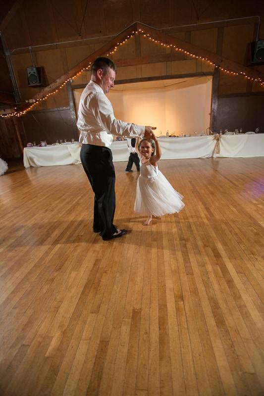 groom dances with little girl