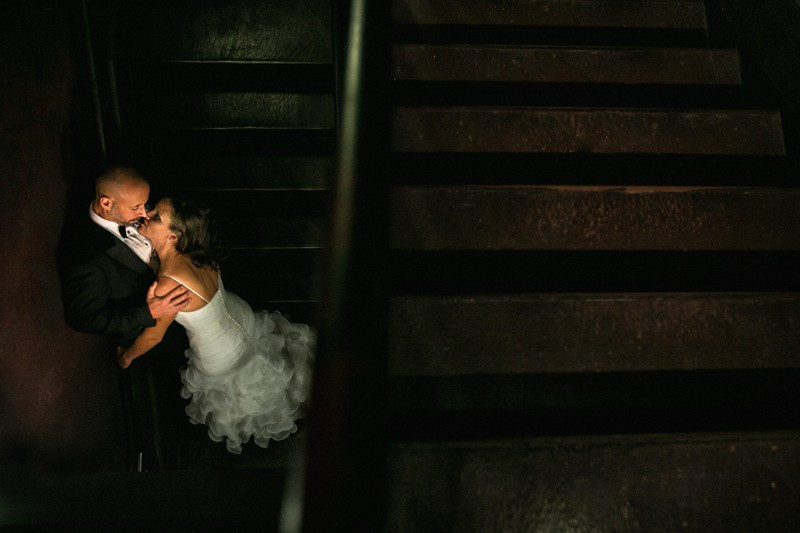 bride and groom in stairwell of house of blues