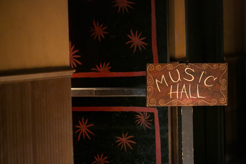 entrance sign to music hall at house of blue
