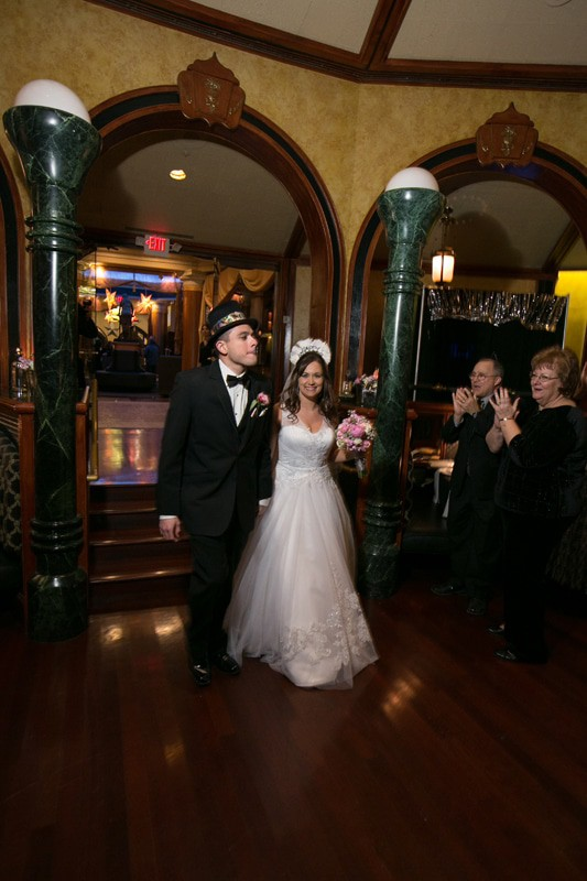 bride and groom enter their wedding reception at tangier