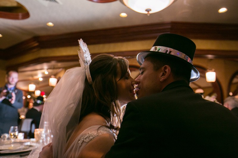 bride and groom kissing at their wedding reception at tangier