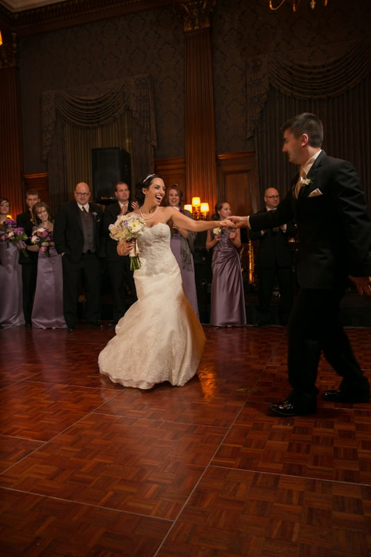 bride and groom enter their wedding reception