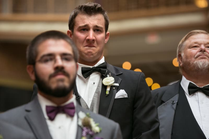 groom getting emotional watchig bride enter wedding at cleveland arcade