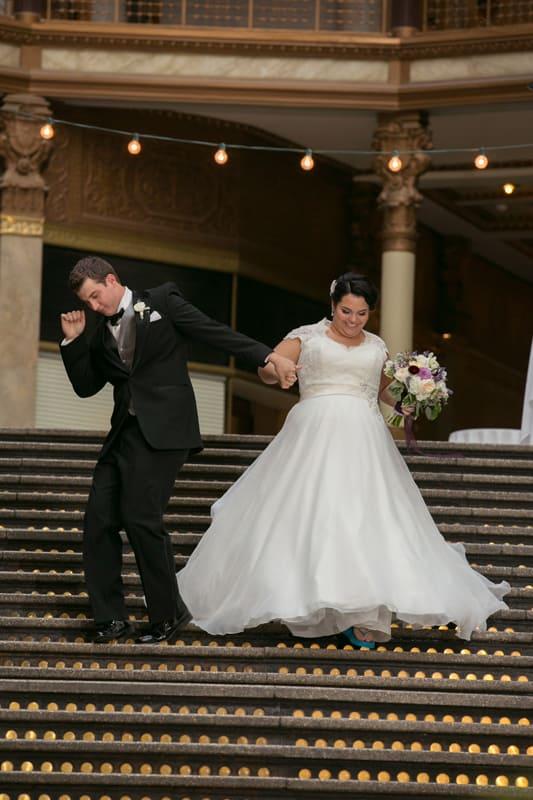 bride and groom enter cleveland arcade wedding reception