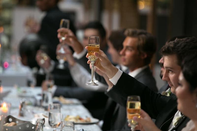 a toast at cleveland arcade wedding reception