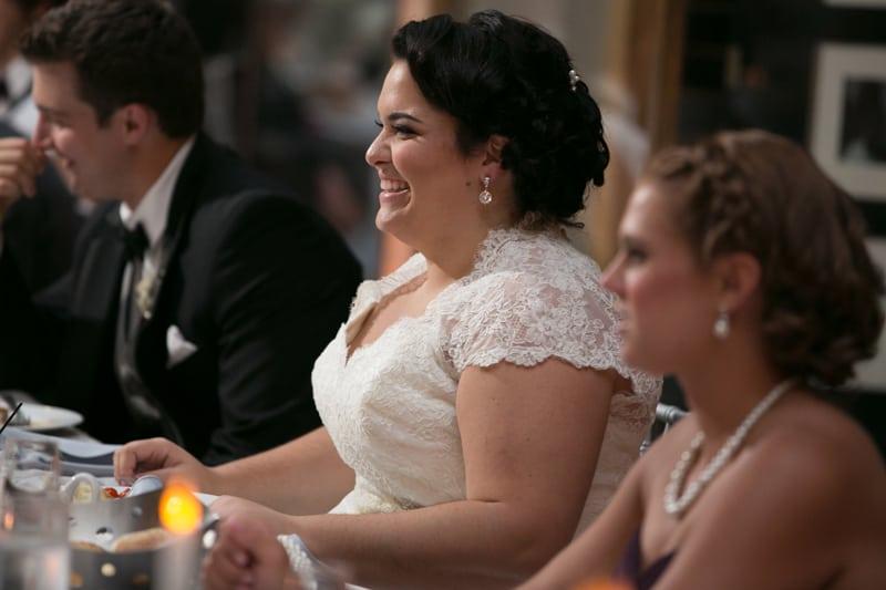 bride laughing at best man speech at cleveland arcade