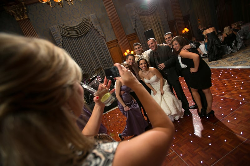 wedding guests taking pictures