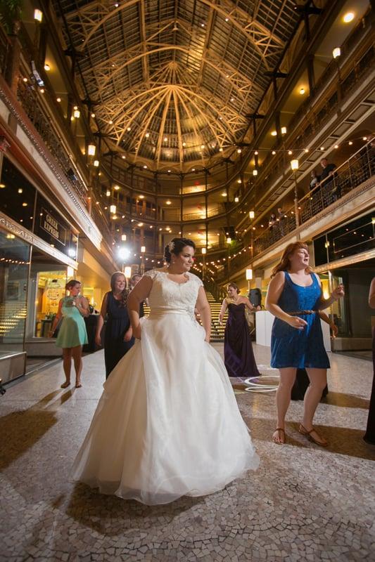 bride dancing at her cleveland arcade wedding reception