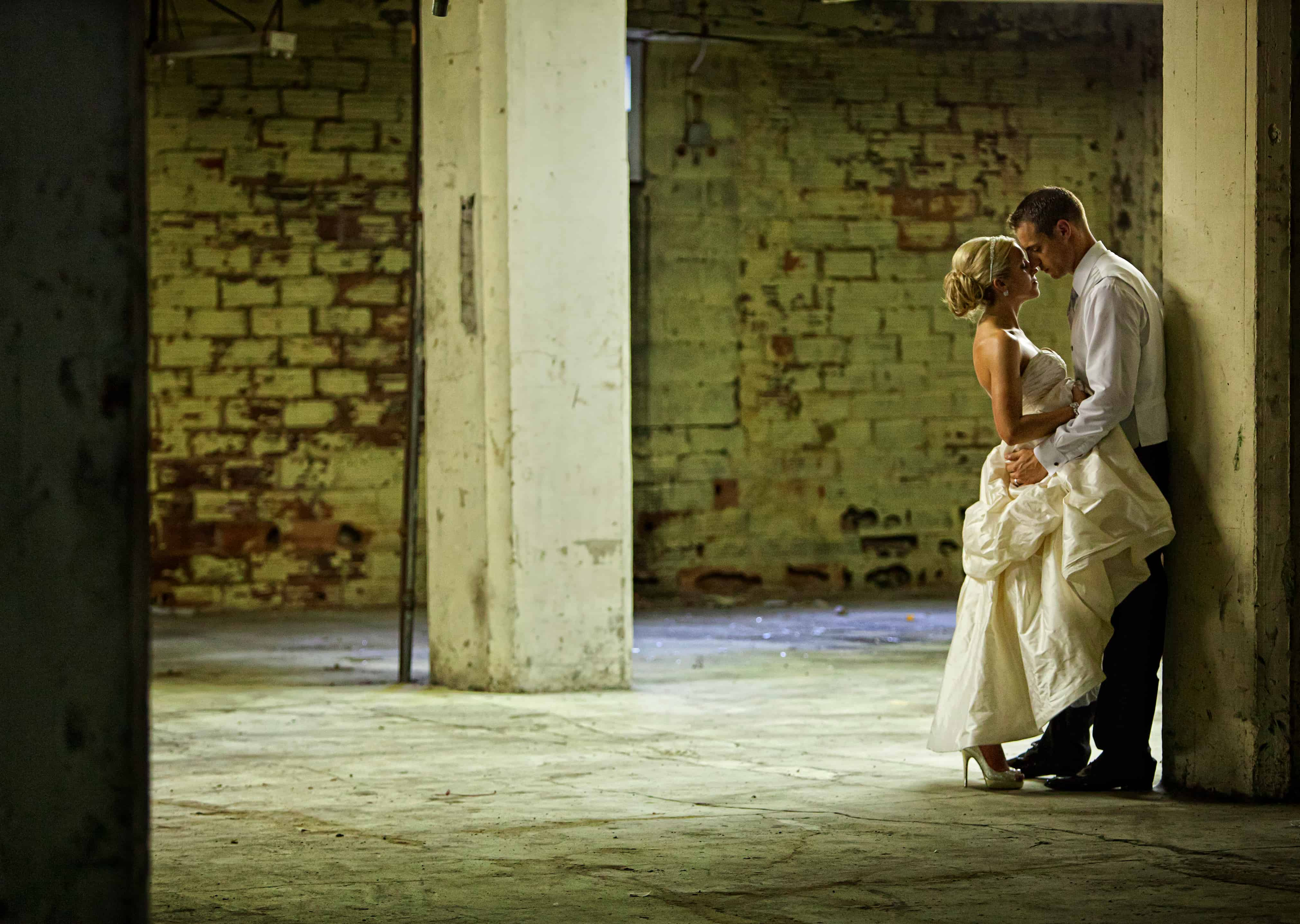 bride and groom picture in old warehouse