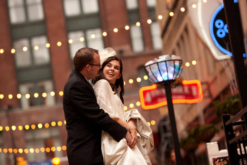 bride and groom hugging on cleveland east fourth street