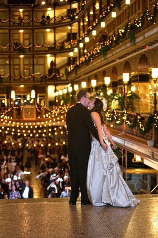 bride and groom enter their wedding reception at cleveland arcade