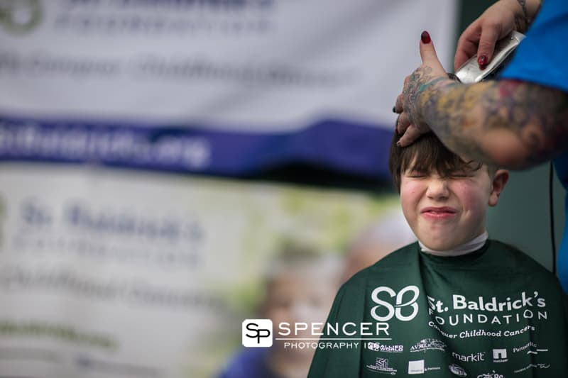 boy getting head shaved at st. baldrick's fundraiser
