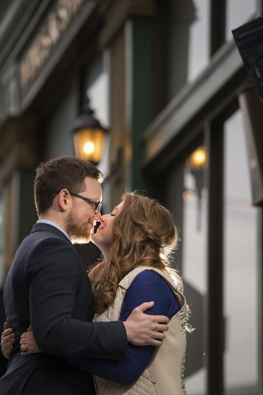 couple kissing at their engagement session in downtown cleveland