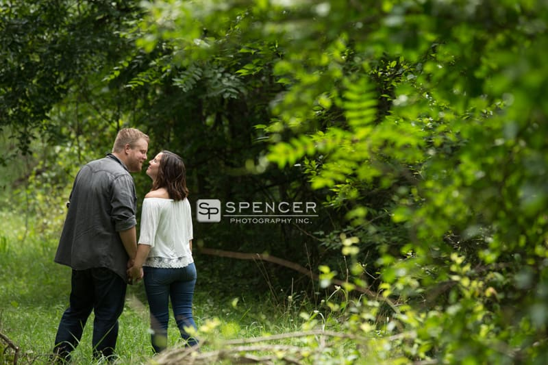 couple kissing in woods