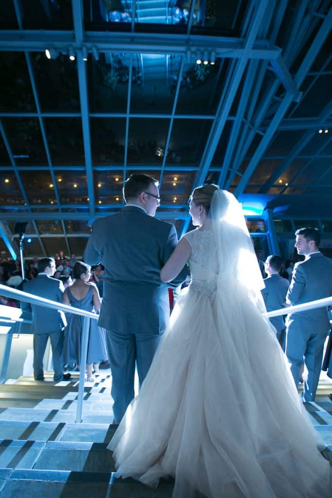 entering their wedding reception at akron art museum