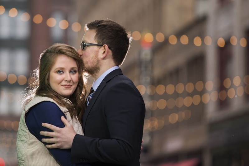 man kisses woman during engagement session in downtown cleveland