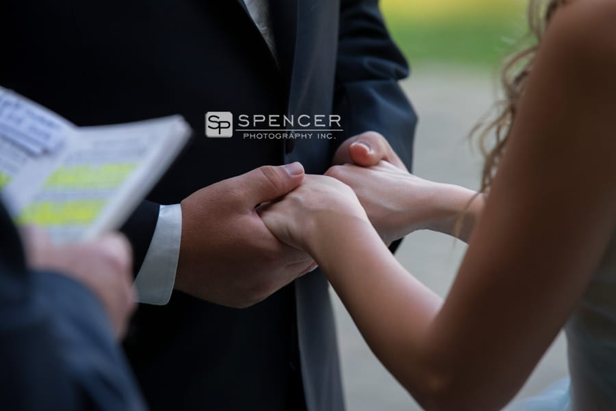 bride and groom holding hands at their wedding ceremony