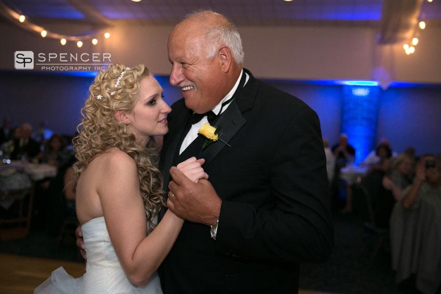 bride dancing with grooms dad