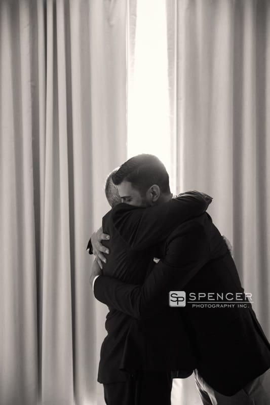 groom hugging brides dad
