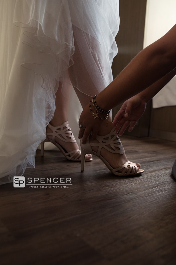 bride putting on shoes at courtyard marriott akron