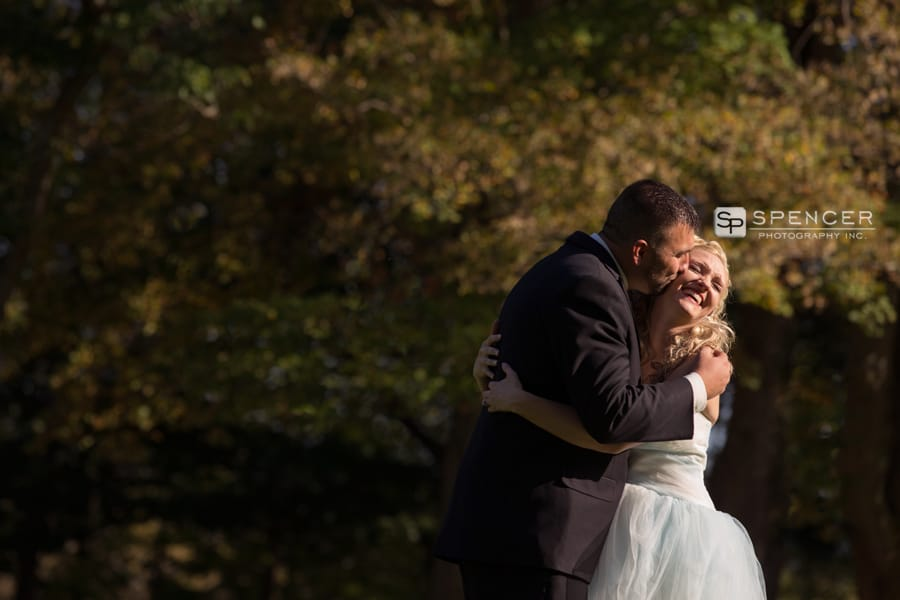 bride and groom kissing at their fall wedding