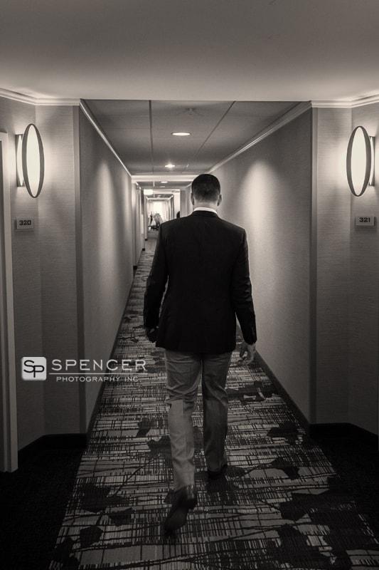 groom walking to wedding