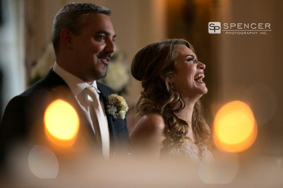 bride laughing at wedding reception at greystone hall