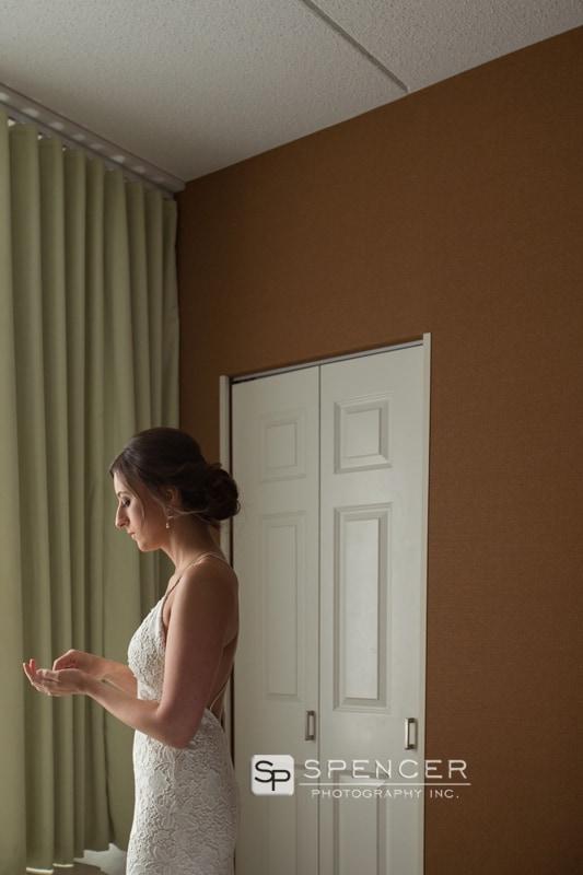 bride holding her wedding earrings