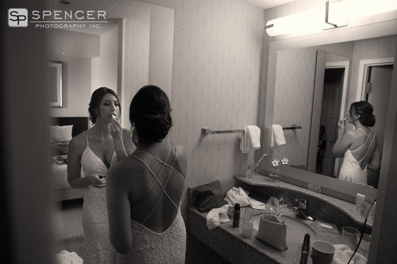 bride putting on lipstick