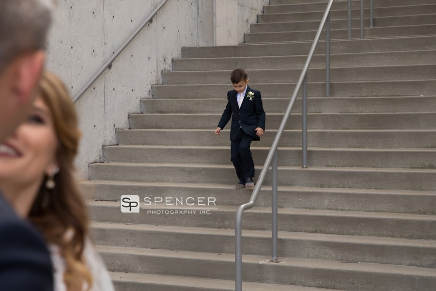 brides son walking down stairs to meet couple