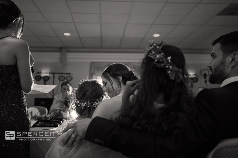 bride hugging flower girl at wedding reception in chagrin falls