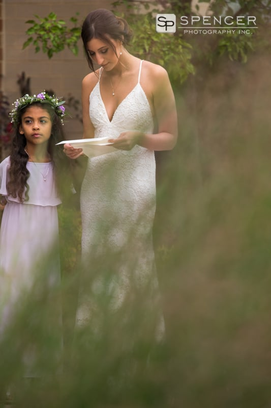 bride reading groom note with flower girl