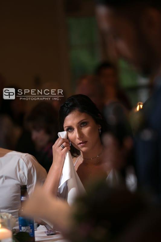 brides maid crying at wedding reception at chagrin valley athletic club