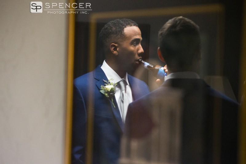 groomsman in reflection at chagring falls wedding