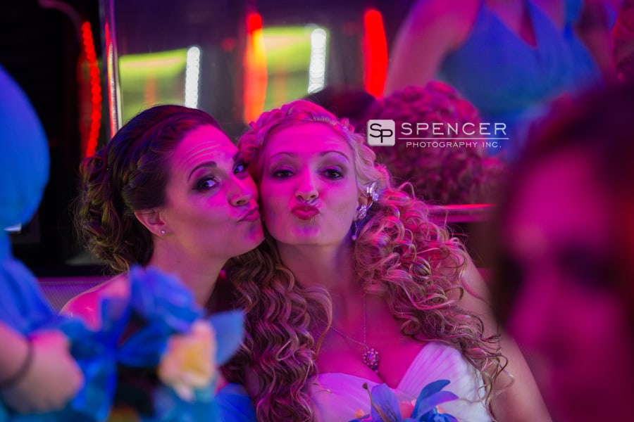 bride and sister on wedding party bus