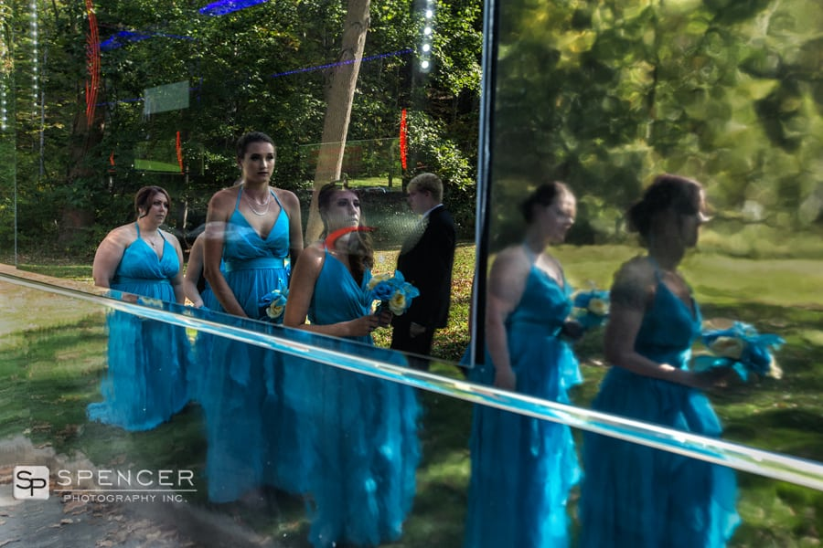 reflection of bridesmaids in party bus