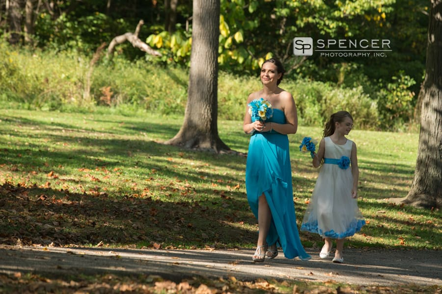 matron of honor walking to wedding ceremony at squires castle