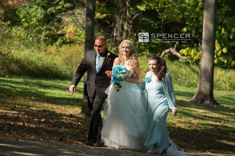 bride walking to wedding ceremony at squires castle