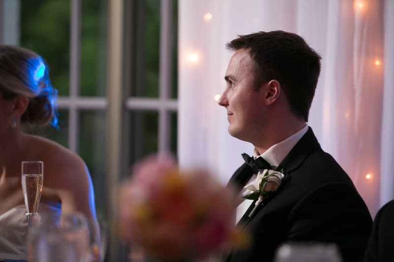 groom watching maid of honor speech
