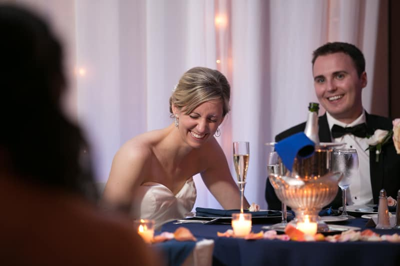 bride laughing at maid of honor speech
