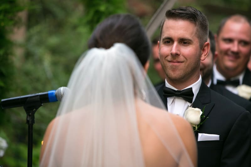 groom smiling at bride and landerhaven wedding