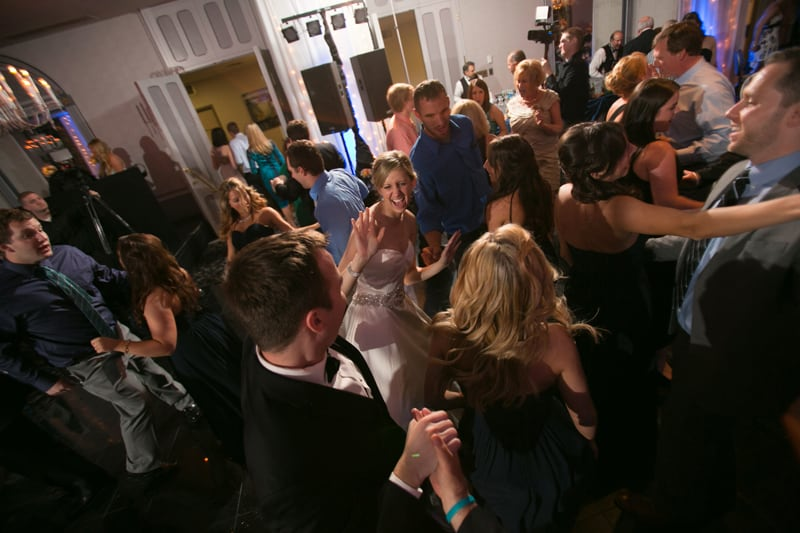 partying at their wedding reception at landerhaven